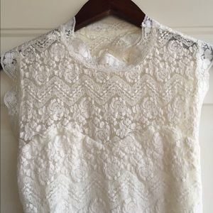 White lace mini dress with open back